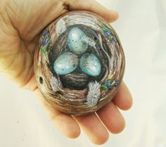 Hand painted bird nest on rock