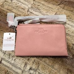 "Pink Blush Coach Wristlet NEW Coach Authentic Pink Blush Pebbled Leather Double Corner Zip Wristlet   Polished pebble leather Inside credit card pockets Zip-top closure, fabric lining Strap with dogleash clip attached Coach Care Card Included Imported. Measurements: Bottom Width: 6 1⁄2"" Depth: 1"" Height: 3 3⁄4"" MSRP $85.00  PayPal Trades ❤️Suggested User Bundles % Authentic Items Smoke Free Home Free Gifts  Ships Same or Next Day ⭐️5 Star Seller Packages Wrapped ✅Reasonable Offers Accepted…"