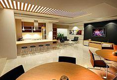 Para quem gosta de cozinhar e receber ao mesmo tempo, o espaço gourmet tem se tornado área cada vez mais bem equipada e confortável, fazendo parte do lazer da família - Divulgação