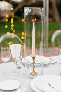 These would be nice on the head table or on accent tables ie. signing your marriage license, guest book, etc. Would be low cost, I would look in antique and second hand stores for the candle holders. I have the clear vases to put them in it would just be the cost of the candle holders and the candle sticks themselves.