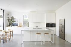 white kitchen with polished concrete floors - Google Search