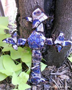 broken pottery made into a cross  http://rustiqueartblog.com/broken-pottery-turns-into-a-piece-of-art/#