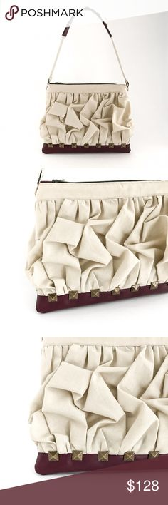 """Shirred Studded Shoulder Bag Walk out in style no matter dressed up or down  with this shirred and pleated shoulder bag.   Exterior: Sandy Beige Cotton, Burgundy Leatherette 9"""" H x 11.5"""" W x 1/2"""" D Interior: Green Floral Cotton, 8.75"""" H x 11"""" WYKK Zipper: 8"""" Strap: 22"""" Brass Pyramid Studs  Please excuse any imperfections as this  is designed exclusively and created by hand.  Price is firm unless bundled (5% off 2+) Brand new condition, arrives with tags attached. Handmade Bags Shoulder Bags"""