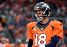 DENVER, CO - NOVEMBER 23: Quarterback Peyton Manning (18) of the Denver Broncos looks at the scoreboard during the first quarter.  The Denver Broncos played the Miami Dolphins at Sports Authority Field at Mile High in Denver on November, 23 2014. (Photo by Tim Rasmussen/The Denver Post)-- #ProFootballDenverBroncos
