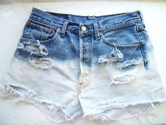 Distressed dip dyed Bleached shorts  How to-  cut the shorts where you want the holes/frays  Mix bleach with water, like 1:1, and then arrange the shorts and leave them in the bleach until they go the white color  Wash and dry. Boom. diy