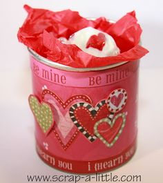 Using a Pringles container, decorate it for Valentine's Day or any other holiday and put cookies or treats in it to give away! I think this is adorable!