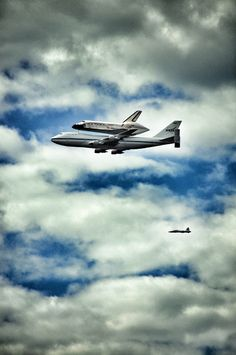 usairforce:  Excellent shot of the Space Shuttle Discovery (OV103) atop the Shuttle Carrier Aircraft and a T-38 trailing behind. Won't see this anymore! Discovery landed in Washington D.C. this morning where she'll eventually be displayed at the Smithsonian.