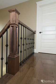 Staircase with black metal spindles and collars