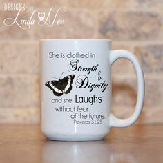 MUG ~ She is Clothed in Strength and Dignity and She Laughs without Fear of the Future ~ Proverbs 31:25 ~ Christian Coffee Mug Bird ~ Christian Mug ~ Coffee Mug ~ Mugs ~ Christian Quote Mug ~ Jesus Mug ~ Christian ~ Christian Coffee Mug ~ Mug   ♥ AVAILABLE SIZES 15 oz 11 oz   ♥ ABOUT OUR MUGS ♥ All designs are personally created by me and exclusive to DesignsbyLindaNee ♥♥♥♥♥ http://etsy.me/1O2ftEU ♥♥♥♥♥ and DesignsbyLindaNeeToo ♥ Each mug is custom imprinted in our studio in Henniker, New…