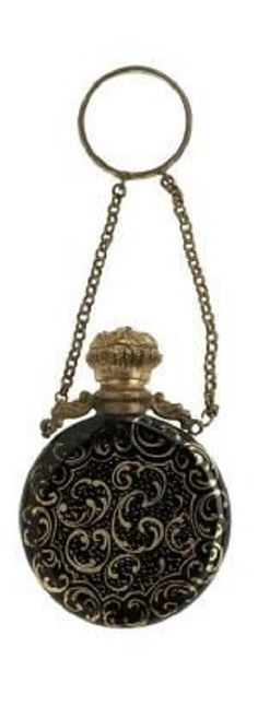 black Hyalith glass painted in gilt with scrolls on a diaper of dots