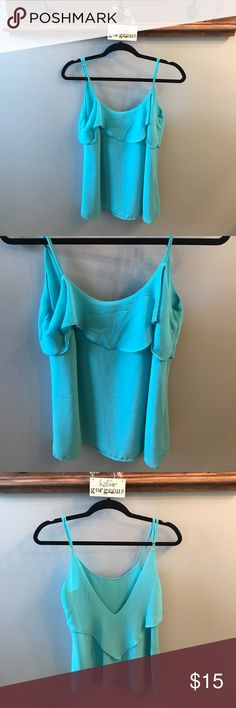 EUC Blue Ruffle Tank with Deep V Back Worn once - Blue tank with ruffle front and deep V back, super sexy and light and airy for summer! Adjustable straps! Naked Zebra Tops Tank Tops