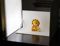 how to make a tabletop softbox, which can help photographers - as well as crafters - take pictures of their smaller work in the best possible light.