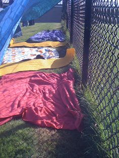 Make reading outside fun by making dens with comfy cushions/ blankets to sit on