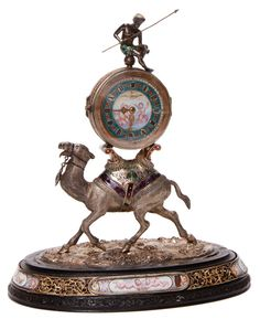 VIENNESE ENAMELED SILVER, ROCK CRYSTAL, FIGURAL REPEATER CLOCK, 19TH CENTURY. Attributed to Hermann Böhm, Vienna, Austria, circa 1880.