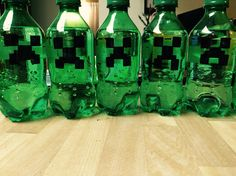 Creeper soda bottles! Just peel off the label and use a permanent marker !