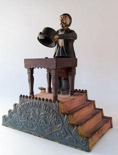 Magician Antique Mechanical Bank » Circa 1901: Designed by virtuoso bank inventor Charles A. Bailey for Cromwell, Connecticut's J. & E. Stevens Company