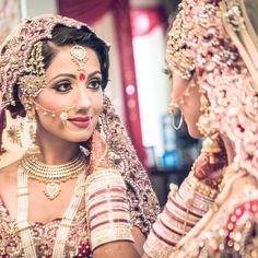 Gorgeous #indianbride looking herself in mirror.