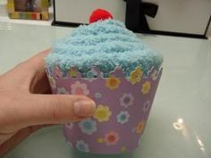 Fuzzy Sock Cupcake Tutorial. Also found a cute poem to attach: This cupcake is not to eat, it was baked with love to warm your feet.