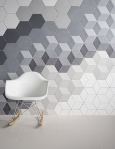 RHYTHM:This image is an example of rhythm because while the tiles on the wall are all the same shape and of a similar color scheme, their dimensions are different. The shapes cannot be repeated evenly or predictably along the wall.