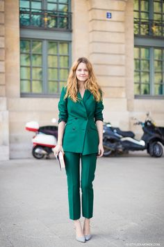 green top and straight leg pants with metallic heels