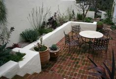Love the potential for herb garden around patio wall