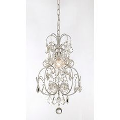If you're looking for lighting to bring sparkle to a small space, this crystal one-light chandelier will do the trick. This dainty but exquisite light fixture is embellished with twinkling crystals that will help illuminate the darkest corner.