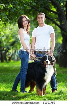 stock photo : Young couple walking with dog in park