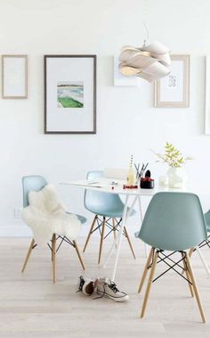 love the chair colour and the wall art placement