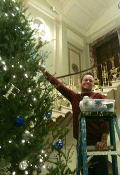 Fisher student Dave Bosch at the Annual Fisher College Holiday Tree Trimming.   -Fisher College-