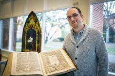 Brian Shetler with the King James Bible he discovered.