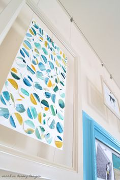 diy wall art: paint watercolors and then cut out with circle punch by sarah m. dorsey designs