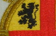 Heraldic Lion embroidered on the first quadrant of a gold coat of arms emblazoned with a red cross.