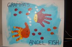 """""""Grampa's Little Angel Fish"""" canvas made with Nathan & Faith's handprints."""