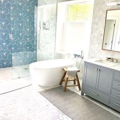 Stunning renovation by Our Electra Marine Bone Cement Tile makes for a simple yet bold bathroom design. Get yours today at… Cement Tiles Bathroom, Blue Tiles, Diy Bathroom Remodel, Vanity Sink, Stone Tiles, Basement Remodeling, Clawfoot Bathtub, Videos, Blue Interiors