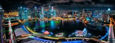New Age - A very difficult 4 image horizontal pano from the top of Marina Bay Sands, Singapore :)  Not easy getting a spot and the tripod setup!