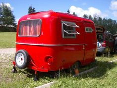 A shot of the really red Boler camper curbside