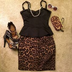 Leopard Print Skirt High quality. Very professional. Zips in back. Has pockets! Forever 21 Skirts Midi