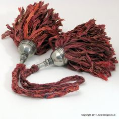 Pair of tassels made of hand dyed imported yarn and a pewter top.