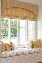 roman shade details - yellow striped roman shade beneath a matching upholstered cornice - Elizabeth Dinkel via Atticmag
