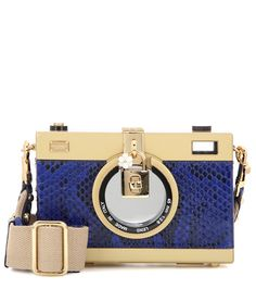 Dolce & Gabbana - Camera Case snakeskin shoulder bag - Dolce & Gabbana charms with the 'Camera Case' shoulder bag with its structured shape and exotic coating of snakeskin. The label's signature turn-lock fastening sits proudly at the front while a see-through window allows you to peek through this box-style bag like a real camera. Carry it in your hand as a conversation starter at your next party. seen @ www.mytheresa.com