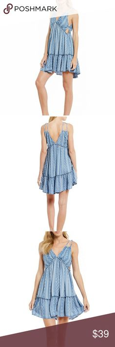 """Gianni Bini chambray dress From GB, this dress features:ditsy printed chambray v-neckline sleeveless styling cutout sides V-back pullover construction 34"""" length cotton/polyester/spandex machine wash Gianni Bini Dresses Mini"""