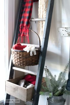An old ladder used as mitten storage with crates and baskets in a front entry / funkyjunkinterior...