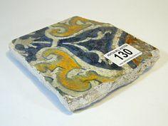 130) Antique glazed tile Est. £5-£10