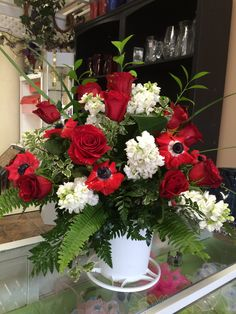 Red roses, red anemones, white stock & greenery by Donna Jeffries