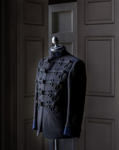 Gieves and Hawkes jacket - military style - where most of men's style comes from. (That and hunting)