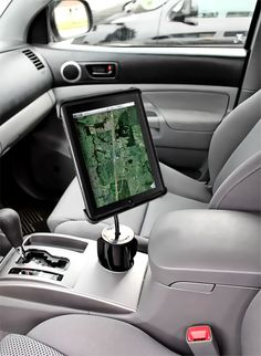 Apple iPad Holders & Mounts - several mounts available. I think the cup holder one would be most convenient. $57.14