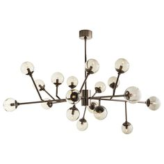 Mid-century inspiration results in this 18 light take on Sputnik. 12 Adjustable arms.
