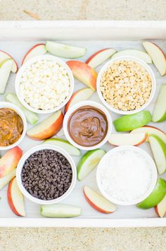 A DIY caramel apple pie bar is the kind of easy dessert station everyone will love. This set-up is delicious, nostalgic, and so much fun. | glitterinc.com | @glitterinc