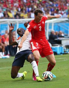 Stephan Lichtsteiner of Switzerland controls the ball against Blaise Matuidi of France during the 2014 FIFA World Cup Brazil Group E match b...