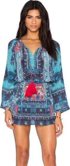 Colors: Blue BUY AT REVOLVE CLOTHING ADD TO WISHLIST FIND THE LOOK PRICE ALERTS DESCRIPTION  Boho Mini Dress. 100 silk. Dry clean only. Unlined. Fringe accented front tie closure. Elasticized waist. Embroidered and beaded detail.  #HemantAndNandita #Blue #Minidress #RevolveClothing #Boho #Chic  #Print #Women #fashion #obsessory #fashion #lifestyle #style #myobsession